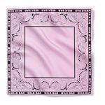 A light pink bandana with off the edge imprint and a one color reactive dye design using a reactive dye print method